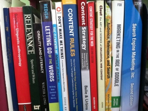 A picture of several content strategy, UX, linguistics and search books on a shelf,